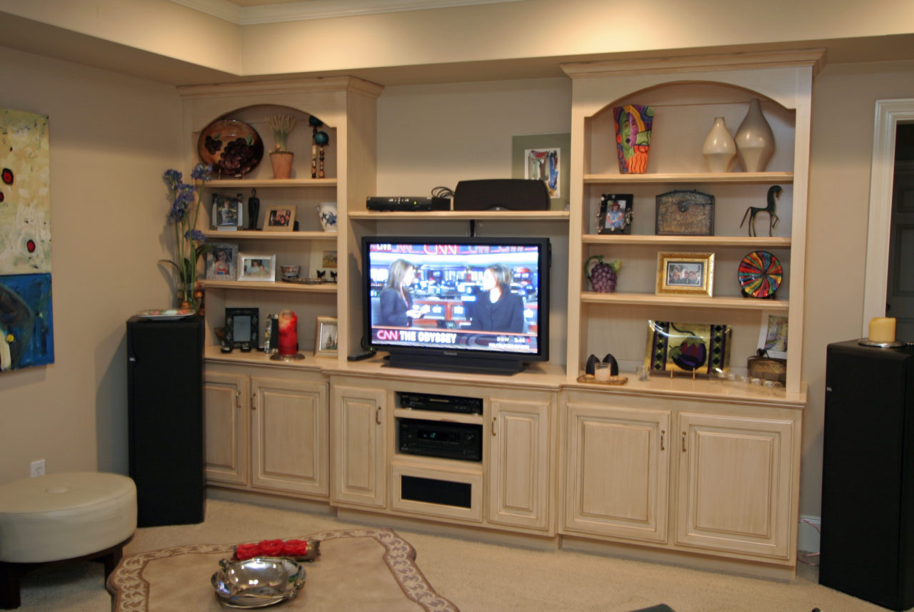 http://creativecabinetryinc.com/wp-content/uploads/2016/11/d-TV-stereo-bookcase-arched-tops-glazed-1280x858.jpg