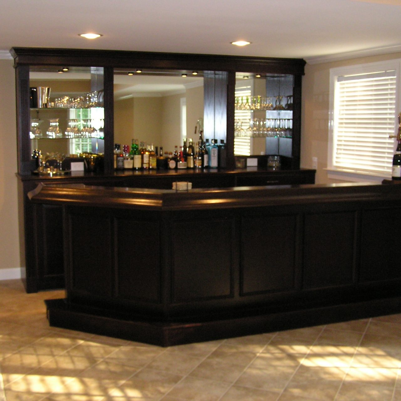 http://creativecabinetryinc.com/wp-content/uploads/2016/12/fb-bar-walnut-wood-dark-stained-1280x1280.jpg