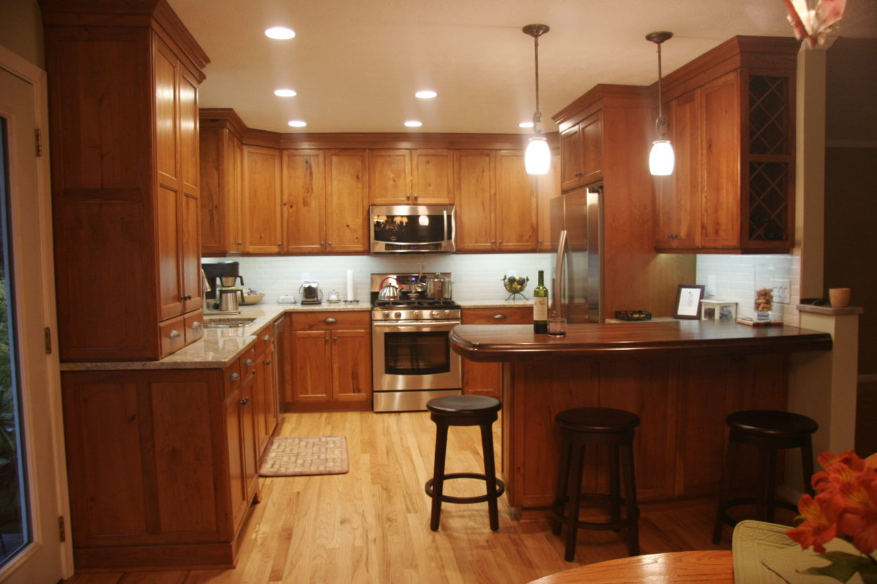 http://creativecabinetryinc.com/wp-content/uploads/2019/02/z-kitchen-cherry-stained-wood-cabinets-and-island-counter-top-1280x853.jpg